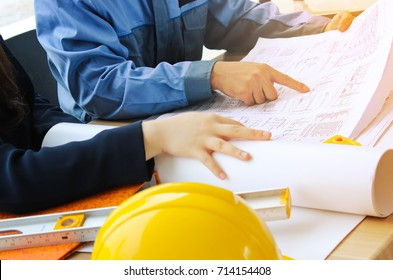 Architect and Engineer Team Discussing the Blueprint on the Table