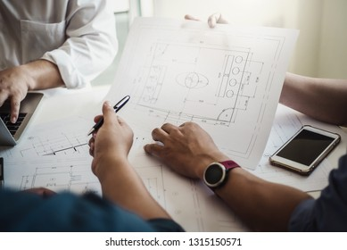Architect or engineer team working with blueprints building plan design project in office Construction engineering tools and structure concept.