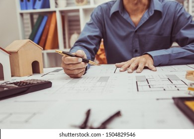 Architect Engineer Working with Blueprints in the office.