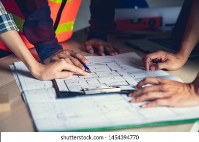Architect & Engineer working drawing document about project planning and progress of work schedule on the home building construction site , Drawing docement is make new for stock NOT COPYRIGHT