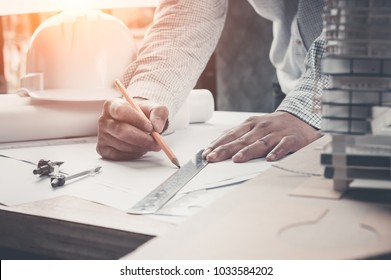 Architect or engineer working in office, Construction, Engineering tools Architects working with drawing sketch project plan blueprint. Corporate Achievement Planning Design Draw