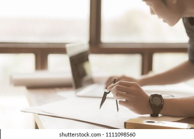 Architect engineer working office construction engineering stock architect or engineer working in office construction engineering tools architects working with drawing sketch malvernweather Gallery