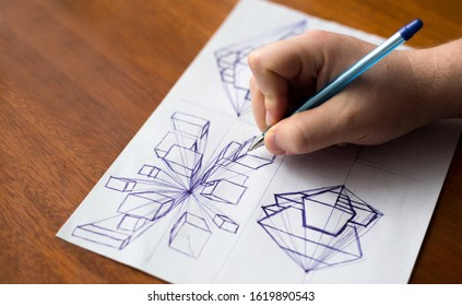 Architect hand drawing Sketch with pen. Man learn to draw perspective. Wooden background