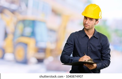 Architect Holding Clipboard And Pen, Outdoors
