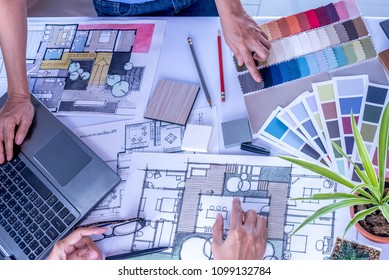 Architect, interior designer (Artist creative) working at table with drawing sketch & laptop computer in office / Home renovation, decoration & Real estate conceptual