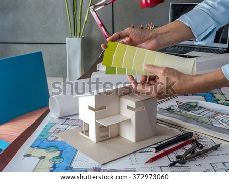 Architect Interior Designer Working Small House Stock Photo Edit Fascinating Blue Interior Design Model