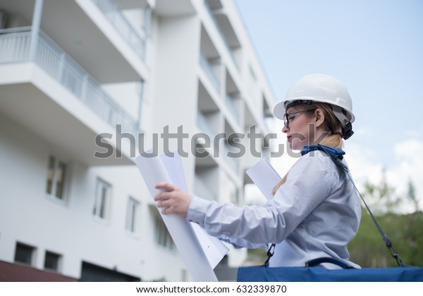 architect looking at project blueprint