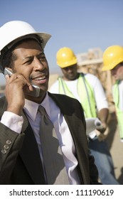Architect making a call at a construction site