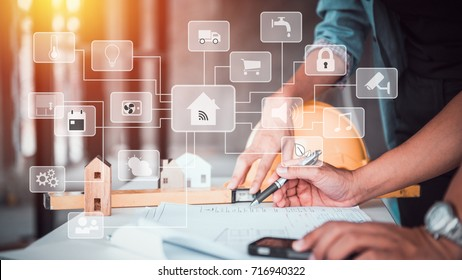 architect man working with blueprints,engineer inspection in workplace for architectural plan,sketching a construction project for smart home