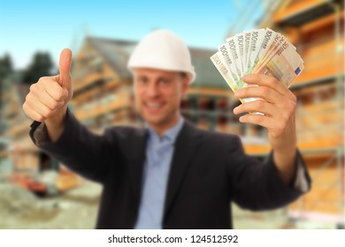 Architect with notes and thumb up in front of a construction site