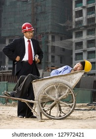 Architect on the job site with a worker.