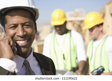 Architect phoning at a construction site