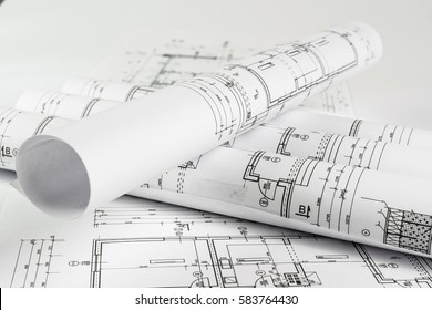 Architect rolls and house plans, close up