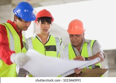 Architect showing construction plans