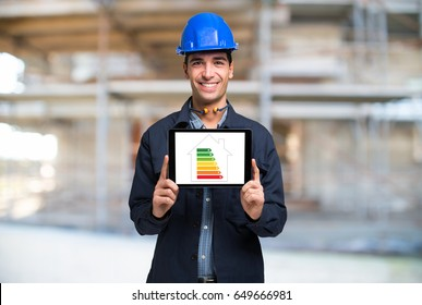 Architect showing an energy efficiency scale on a tablet