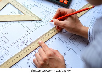 Architect sketching a construction project, view from the top . Architectural blueprints