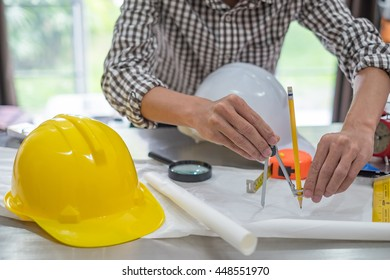 Architect sketching a construction project at work