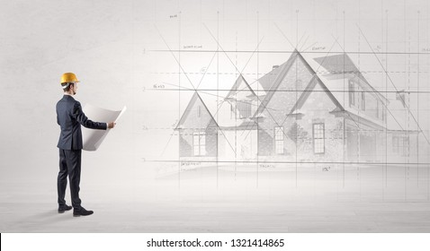 Architect standing and watching an imagined house plan