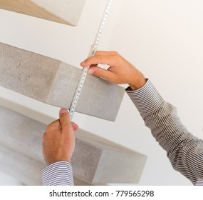 Architect taking measures of a concrete steps staircase. Home style and design concepts