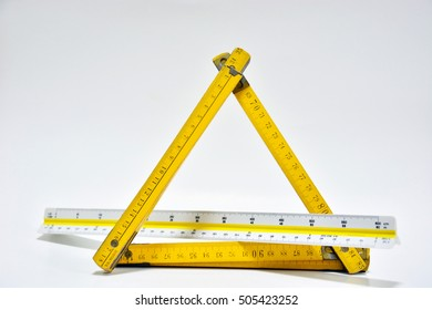 architect tools,folding ruler scale and white paper with white background