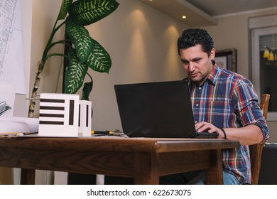 Architect using laptop at office