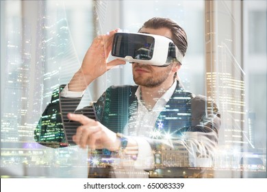 Architect in VR glasses working in augmented reality of city space. Man wearing virtual reality glasses, pointing at digitally simulated urban view. Businessman in 3d goggles interacts with cyberspace