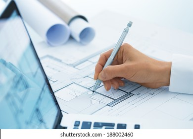 Architect Woman drawing on print construction project