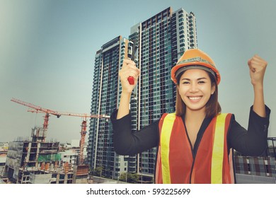 Architect woman with orange helmet, hand holding walkie talky isolated on white background