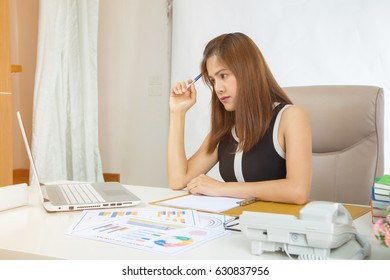 architect women working with laptop and paper charts and graphs