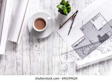 Architect at work. Drawing and tools on light wooden desk top view copyspace