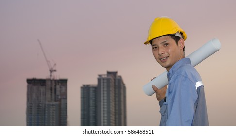 Architect  working with blueprint in construction area
