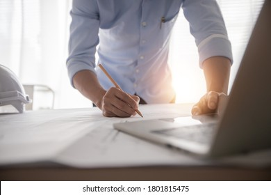Architect working in office with blueprints,engineer thinking and planning inspection in workplace for architectural plan,sketching a construction project,Business construction concept.