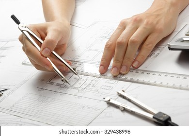 Architect working on blueprint. Architects workplace - architectural project, blueprints, ruler, calculator and divider compass. Construction concept. Engineering tools