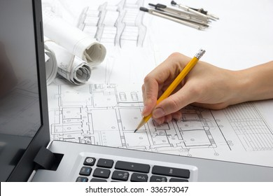 Autocad imgenes pagas y sin cargo y vectores en stock shutterstock architect working on blueprint architects workplace architectural project blueprints laptop and divider malvernweather Image collections