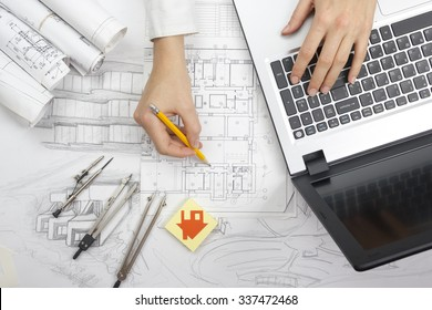 Architect working on blueprint. Architects workplace - architectural project, blueprints, laptop and divider compass, pencil. Construction concept. Engineering tools. Top view
