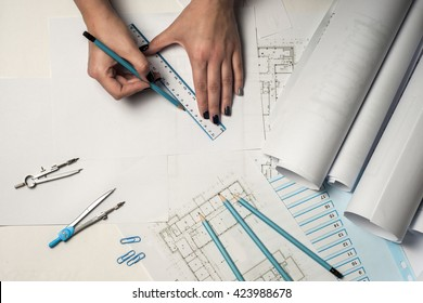 Architect working on blueprint. Architects workplace - architectural project, blueprints, ruler and divider compass. Construction concept. Engineering tools. Top view