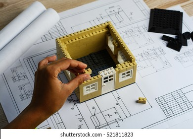Architect working on blueprint. Architects workplace - architectural project, blueprints, laptop and divider compass, pencil. Construction concept. Engineering tools