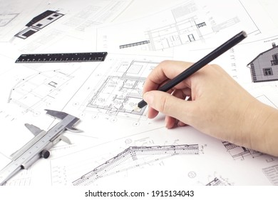 Architect working on blueprint. Construction concept. Engineering tools. Architectural plan,technical project and constructions