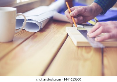 Architect working on drawing table in office