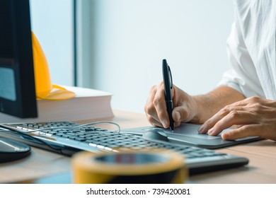 Architect working with sketch pen tablet and CAD software in architecture project and design studio