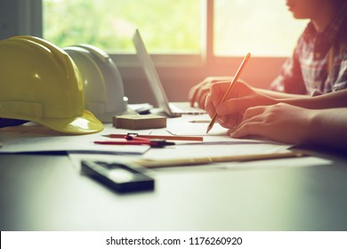 Architect workplace,pencil on blueprint ,ruler, calculator, laptop and divider compass. Construction concept. Engineering tools.