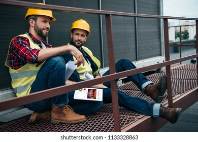 Soundcloud images stock photos vectors shutterstock architects with blueprints and digital tablet with soundcloud website sitting on construction malvernweather Gallery