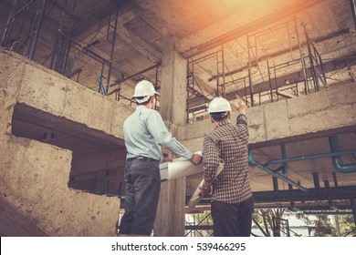 Architects, In construction site engineer, image effect Vintage tone, sun flare