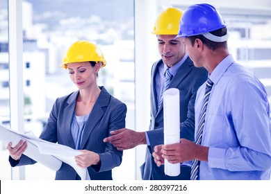 Architects discussing their plans in the office