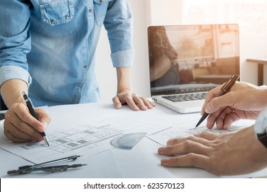 Architects engineer discussing at the table with blueprint - Closeup on hands and project print, Team group on construciton site check documents and business workflow.