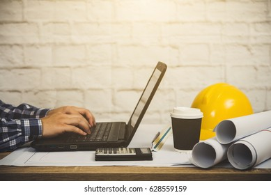 Architects engineer using notebook design and drawing plan with blueprint. choose closeup, project print, construction site check documents and business work flow. Successful architect. Vintage style.