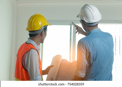 Architects and engineers examine the interior of the home to create a successful building plan before delivering quality housing to the customer.