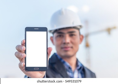 Architects holding a smartphone with isolated white screen.