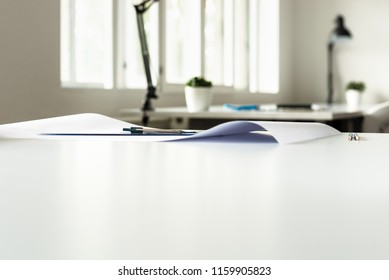 Architects office in a low angle view across the table with foreground copy space.