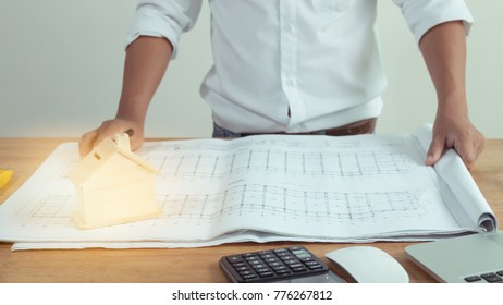 Architects who work on blueprints. Architect's Workplace - Architectural Blueprint Project Construction concept Engineering tools